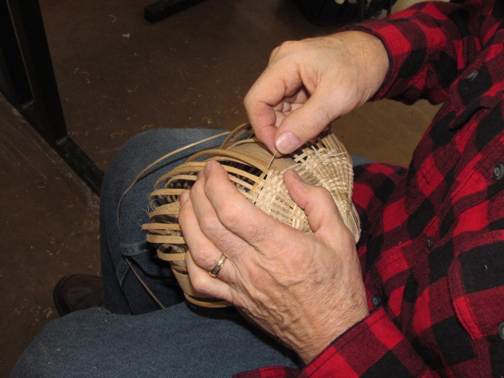 Man weaving a basket